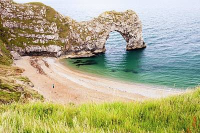 Sea Arch Photograph - Durdle Door A Famous Sea Arch by Ashley Cooper