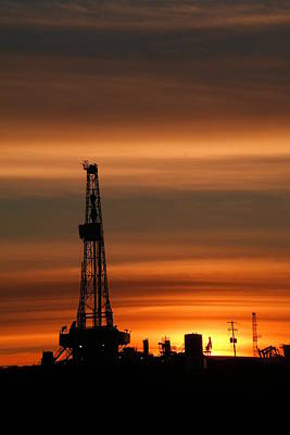 Birds Rights Managed Images - Dusk and an oil rig Royalty-Free Image by Jeff Swan