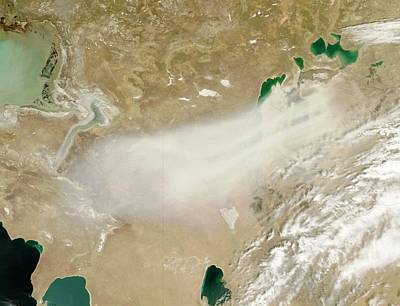 Kazakhstan Photograph - Dust Storm Over The Aral Sea by Nasa/jeff Schmaltz