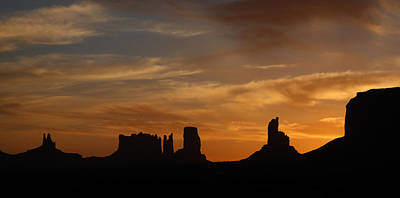 Photograph - Early Sunrise Over Monument Valley by Jean Clark