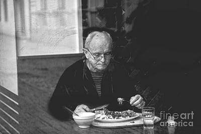 Photograph - Eating Alone by Rick Bragan