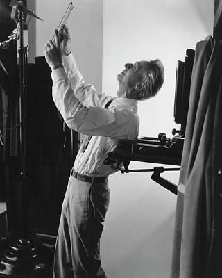 Photograph - Edward Steichen Examining A Negative by George Hoyningen-Huene