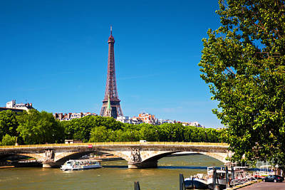 Paris Skyline Royalty-Free and Rights-Managed Images - Eiffel Tower and bridge on Seine river in Paris France by Michal Bednarek