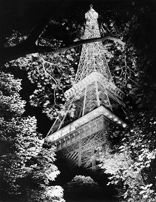 Part Of Photograph - Eiffel Tower At Night by Underwood Archives