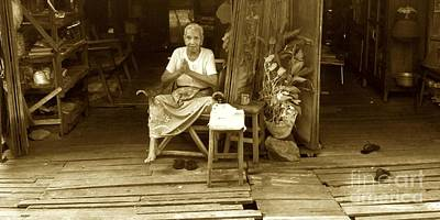 Photograph - Elderly Burmese Lady Sitting In Front Of Her Home 33rd Street Chanayethazan Mandalay Burma by Ralph A  Ledergerber-Photography