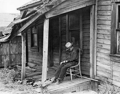 Dilapidated Photograph - Elderly Man Doses On His Porch by Underwood Archives