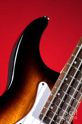 Photograph - Electric Bass Guitar On Red by M K Miller