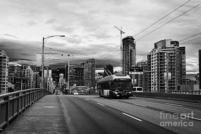 electric bus on granville street bridge over false creek Vancouver BC Canada Print by Joe Fox
