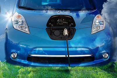 Photograph - Electric Hybrid Car Plugged In by Gunter Nezhoda