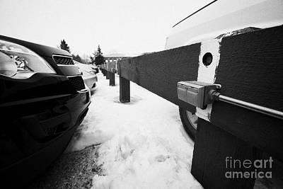 Electrical Power Sockets In Outdoor Parking Lot For Engine Block Heaters Saskatchewan Canada Art Print