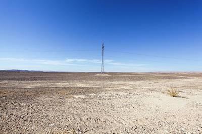 Electricity Pylon In Desert Art Print by Photostock-israel