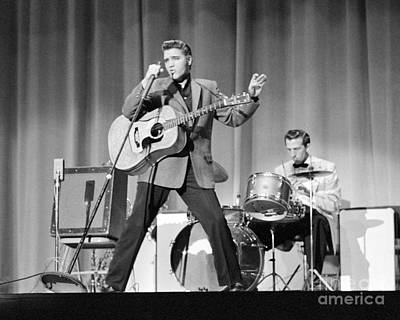 Musicians Photo Rights Managed Images - Elvis Presley and D.J. Fontana performing in 1956 Royalty-Free Image by The Harrington Collection