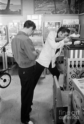 Elvis Presley Photograph - Elvis Presley At An Arcade 1956 by The Harrington Collection