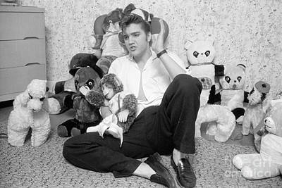 Elvis Presley Photograph - Elvis Presley At Home With Teddy Bears 1956 by The Harrington Collection