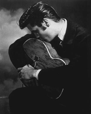 Gospel Music Photograph - Elvis Presley Kisses Guitar by Retro Images Archive