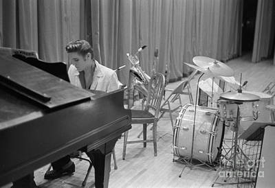 Musicians Photo Rights Managed Images - Elvis Presley on piano waiting for a show to start 1956 Royalty-Free Image by The Harrington Collection