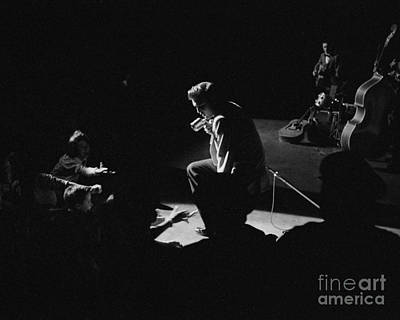 Musicians Photo Rights Managed Images - Elvis Presley on stage at the Fox Theater in Detroit 1956 Royalty-Free Image by The Harrington Collection