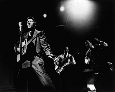 King Of Rock And Roll Photograph - Elvis Presley Playing Hard  by Retro Images Archive