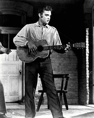 Sex Symbol Photograph - Elvis Presley Playing Outside  by Retro Images Archive