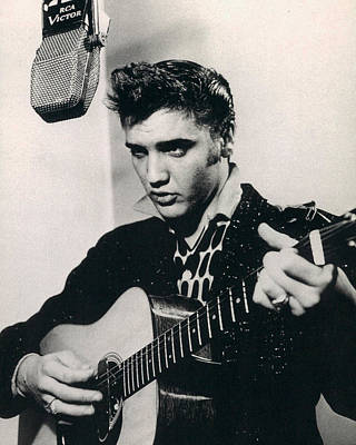 Blue Photograph - Elvis Presley Plays And Sings Into Old Microphone by Retro Images Archive