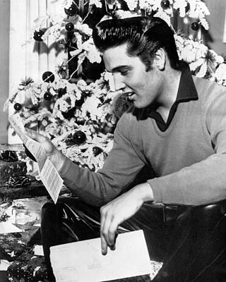 Movie Star Photograph - Elvis Presley Reads Letter by Retro Images Archive