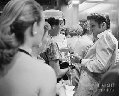 Elvis Presley Signing Autographs At The Fox Theater 1956 Art Print by The Harrington Collection