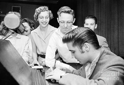 Autograph Photograph - Elvis Presley Signing Autographs For Fans 1956 by The Harrington Collection