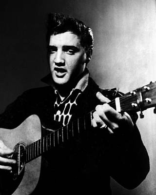 Movie Star Photograph - Elvis Presley Strums The Guitar by Retro Images Archive