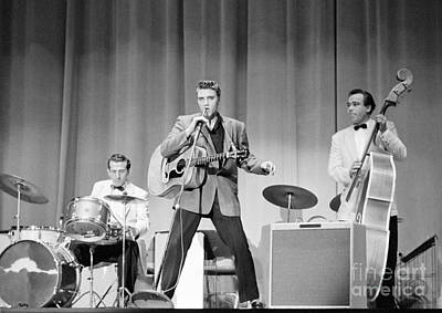 Musicians Photo Rights Managed Images - Elvis Presley with D.J. Fontana and Bill Black 1956 Royalty-Free Image by The Harrington Collection