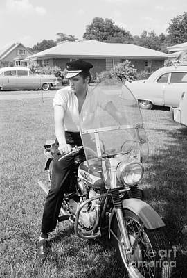 Musicians Photo Rights Managed Images - Elvis Presley with his 1956 Harley KH and his Cadillacs Royalty-Free Image by The Harrington Collection