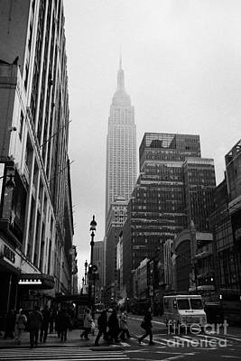 Empire State Building Shrouded In Mist As Pedestrians Crossing Crosswalk On 7th Ave And 34th Street  Print by Joe Fox