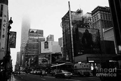 empire state building shrouded in mist from west 34th Street and 7th Avenue new york city usa Art Print by Joe Fox