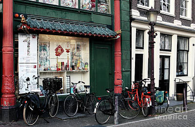 Photograph - Empty Bikes by John Rizzuto