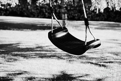 Missing Child Photograph - Empty Plastic Swing Swinging In A Garden In The Evening by Joe Fox