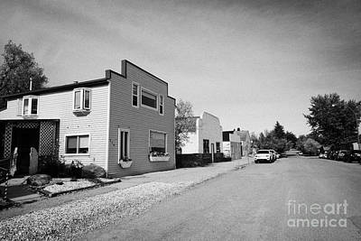 empty unused abandoned stores converted to homes on the town of leader sk Canada Art Print by Joe Fox