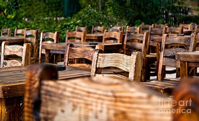 Empty Wooden Chairs And Tables Art Print