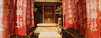 Red Abstract Photograph - Entrance Of A Shrine Lined With Flags by Panoramic Images