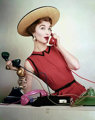 1950s Fashion Photograph - Evelyn Tripp Holding Telephones by Erwin Blumenfeld