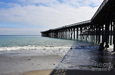 Art Print featuring the photograph Evening Pier Shadows Are Lost In The Surf by Debby Pueschel