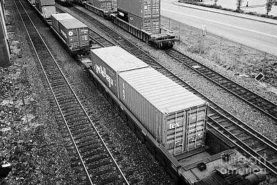 Freight Train Photograph - evergreen and tex freight shipping containers on rail cars freight train goods tracks Vancouver BC C by Joe Fox