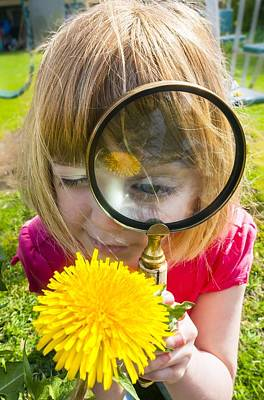 Examining Flower With Magnifying Glass Art Print