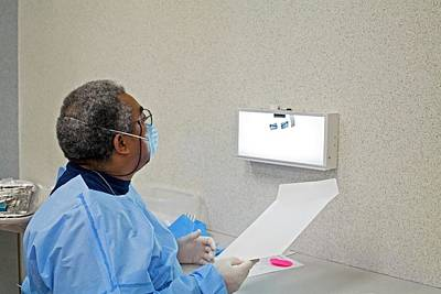 Ada Photograph - Examining Tooth X-rays by Jim West