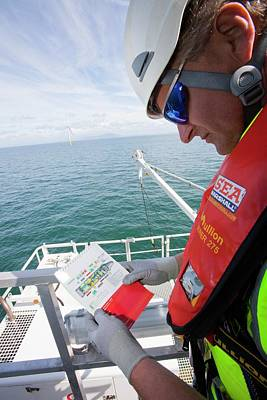 Rotor Blades Photograph - Executive Climbs A Wind Turbine by Ashley Cooper