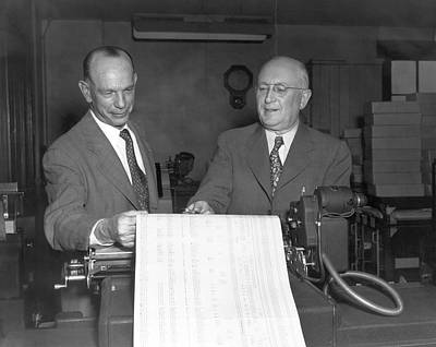 Executives Viewing Data Sheets Print by Underwood Archives