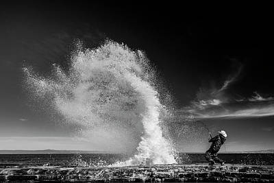 Coast Photograph - Extreme  Fishing by Vahid Varasteh