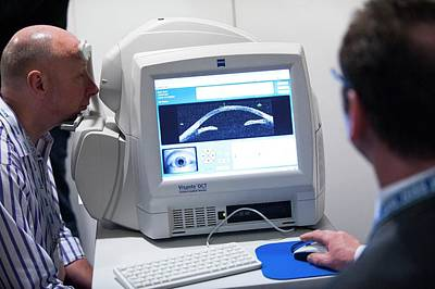 Ophthalmologists Photograph - Eye Tomography Scanner Demonstration by Dan Dunkley