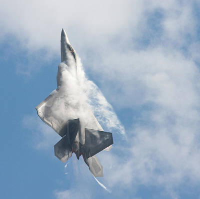 Art Print featuring the photograph F-22 Raptor Creates Its Own Cloud Camouflage by Nathan Rupert