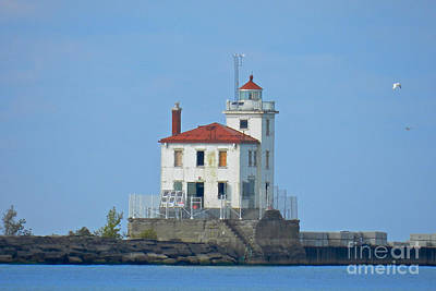 Modern Man Surf Royalty Free Images - Fairport Harbor West Breakwater Light Royalty-Free Image by Lori Amway