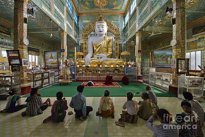 faithful Buddhists praying at sitting Buddha in golden Ponnya Shin Pagoda Original