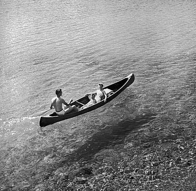 Sixties Photograph - Family Canoe Excursion by Underwood Archives